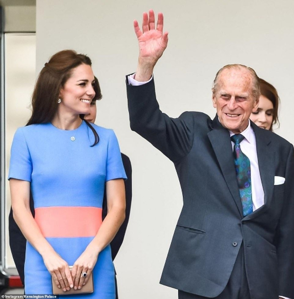 Kate Middleton is seen smiling with the Duke of Edinburgh in the second photo released on the Cambridges