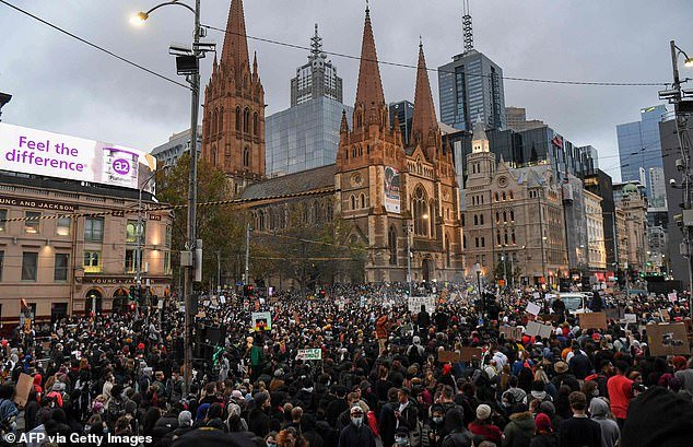 A Black Lives Matter protester has tested positive for coronavirus after attending a rally in Melbourne. Pictured: The protest
