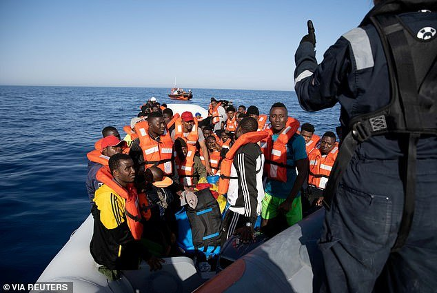 A file photo shows migrants on board the German NGO search and rescue ship Sea-Watch 3 in Porto Empledocle, Italy on June 17