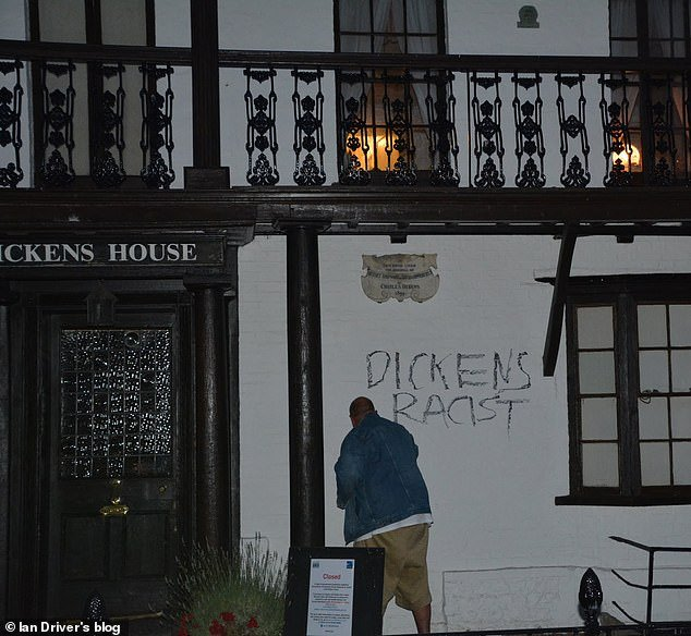 Ian Driver pictured scrawling graffiti on the Charles Dickens museum in Broadstairs, Kent, on Saturday