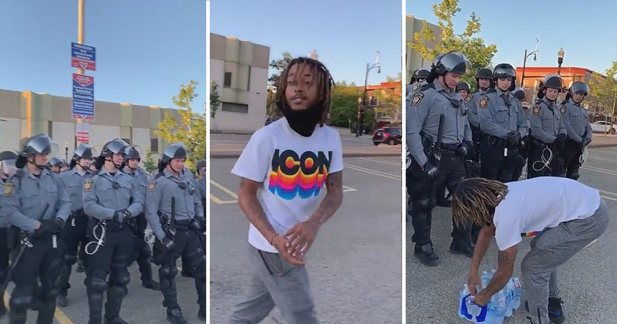 adfadf.jpg?resize=412,232 - Heartwarming Moment Protester Brings Water To Police Officers During 'Black Lives Matter' March