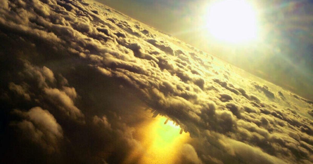 mark hersch nasa.jpg?resize=1200,630 - NASA Shares Magnificent Image Of 'Upside-Down City' Below Clouds