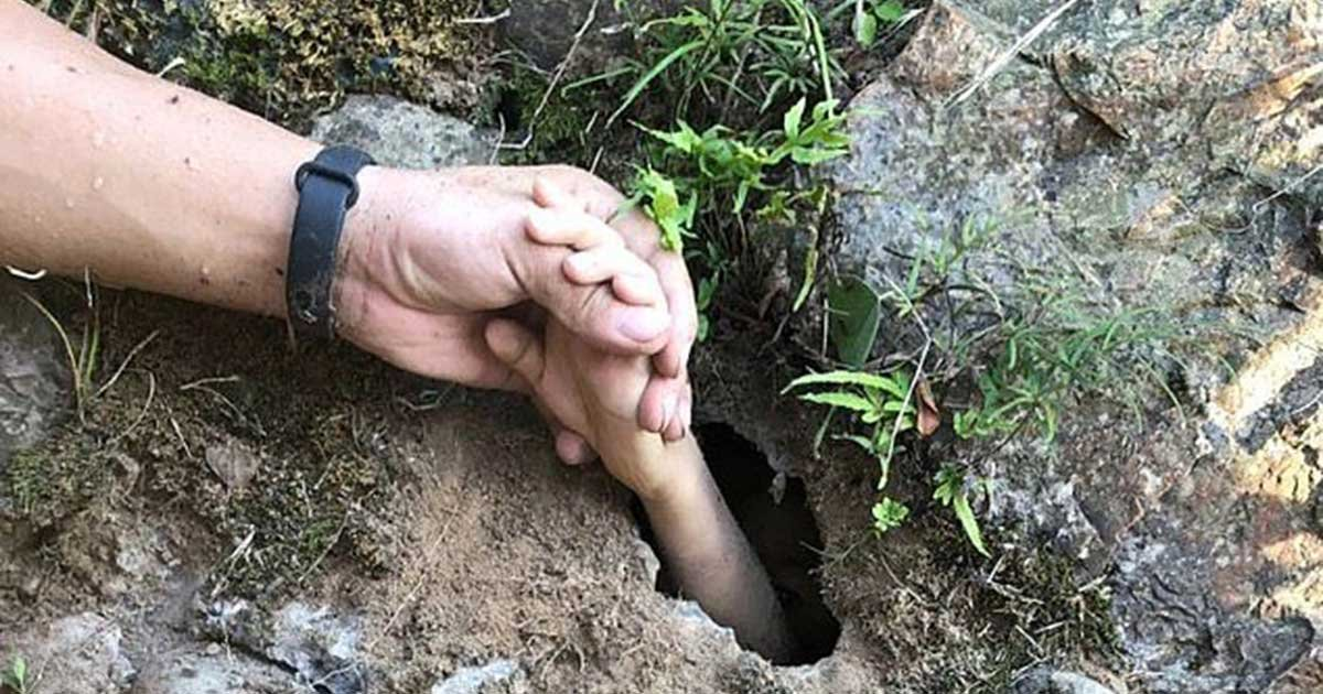 1 156.jpg?resize=412,275 - Rescuers Saved Young Boy By Grabbing His Hand Through A Tiny Hole