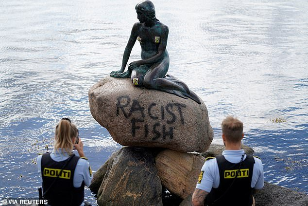 "A graffiti reading ""Racist Fish"" is seen on a statue of ""The Little Mermaid"" in Copenhagen, Denmark July 3"