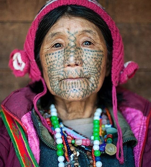 tattooed face woman