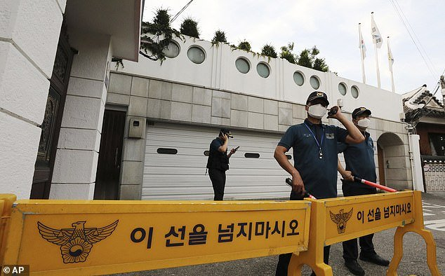 Police officers stood guard in front of Park Won-Soon