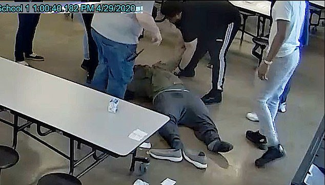 Toward the end of the video the teen appeared to be limp and fell back to the floor after some staffers attempted to sit him up