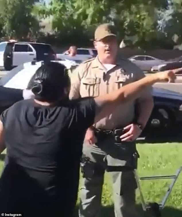 In the 11 minute video posted by Collins, dozens of bystanders are heard pleading with the cops that the three boys are innocent and they're attempting to detain 'the wrong guy'
