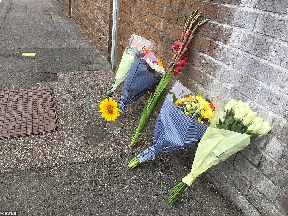 Residents gathered this morning to lay flowers, above, in tribute to the child.An investigation is underway into the incident which neighbours have called a