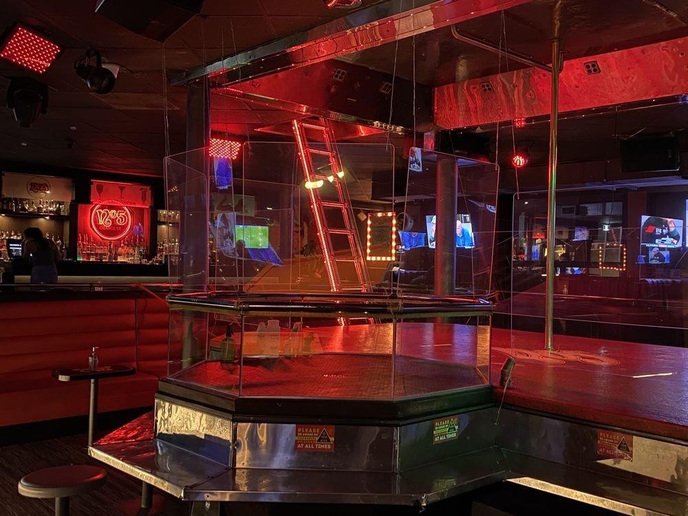 Dancers protected by Plexiglas at popular Vancouver strip club ...