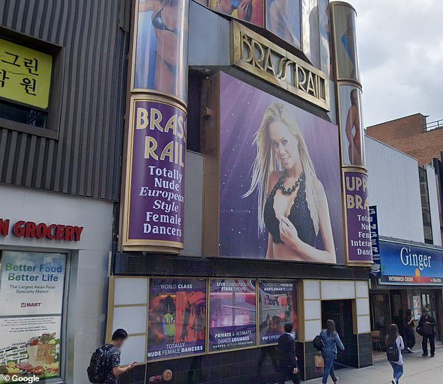 A worker at Brass Rail strip club in Toronto (pictured) tested positive for coronavirus