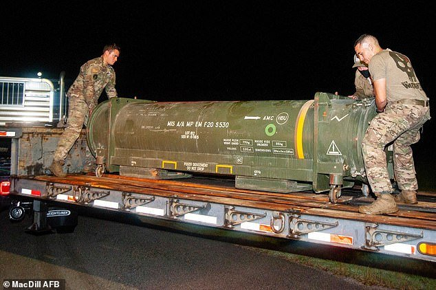 Members of the 6th Civil Engineer Squadron Explosive Ordnance Disposal Flight at MacDill Air Force Base remove a French air-to-air missile delivered to Draken International at Lakeland Linder International Airport in Florida