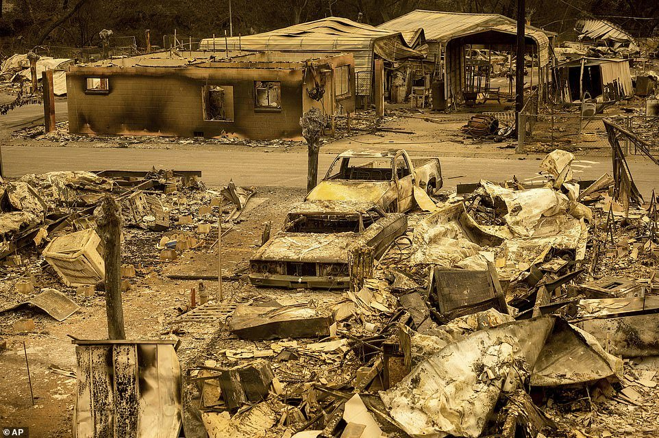 Scorched homes and vehicles fill Spanish Flat Mobile Villa following the LNU Lightning Complex fires in unincorporated Napa County, California.At least four civilians were injured in the fires in this area