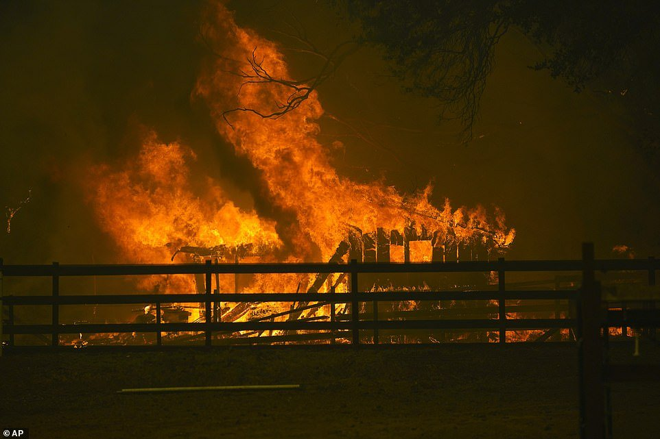 A structure is damaged by the CZU August Lightning Complex Fire in Santa Cruz County on Thursday. Evacuation orders were issued across the county Thursday evening as it was revealed there is zero percent containment on the fires in this zone