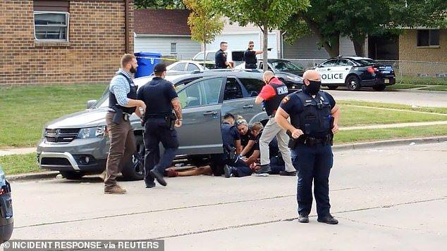 cops shoot black man