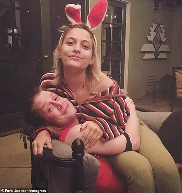 Pals forever: Here Paris is seen with bunny ears as she sits on Culkin at home