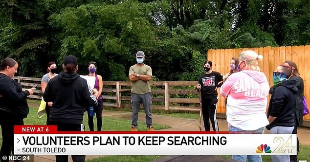 Volunteers are seen on Monday searching for Braylen around his family