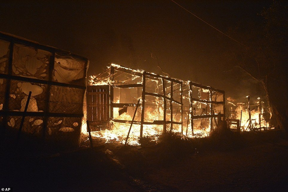 Fire rips through makeshift tents at the Moria camp on the Greek island of Lesbos, as police launch an arson investigation