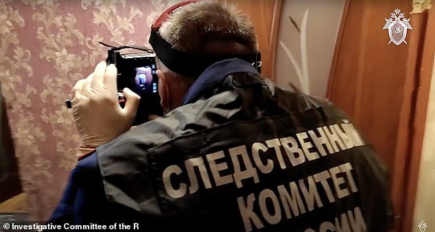 Investigators can be seen working at the scene of the crime. Local media reported that Molchanov managed to keep his past convictions secret from Saprunova