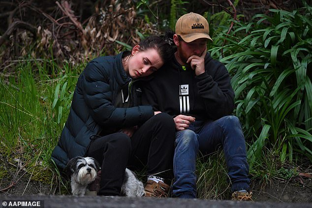 Friends console each other at the scene after police confirmed William