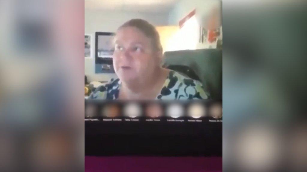 teacher explains to students
