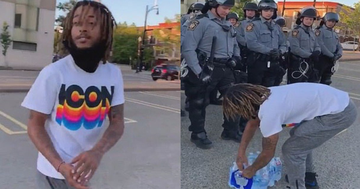 e18486e185aee1848ce185a6 2020 10 13t172441 535.jpg?resize=1200,630 - Heartwarming Moment Protester Brings Water To Police Officers During 'Black Lives Matter' March
