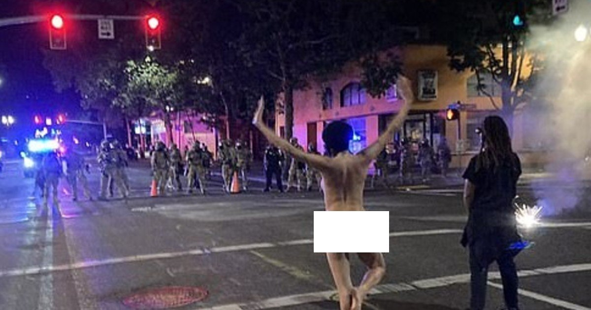 e18486e185aee1848ce185a6 76 1.jpg?resize=412,232 - 'Nude Athena' Taunted Anti-Riot Officers During Intense Stand-Off