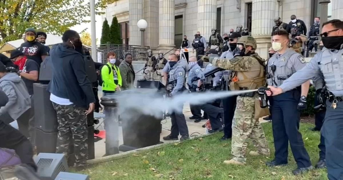 1 10.jpg?resize=1200,630 - Law Enforcement Used Pepper Spray To Break Up A North Carolina March To A Polling Place