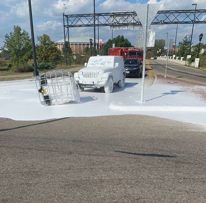 A Truck Carrying A Tank Of White Paint Dropped It On The Road