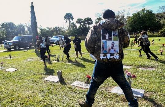 Mother of slain Florida teen shot during his burial service