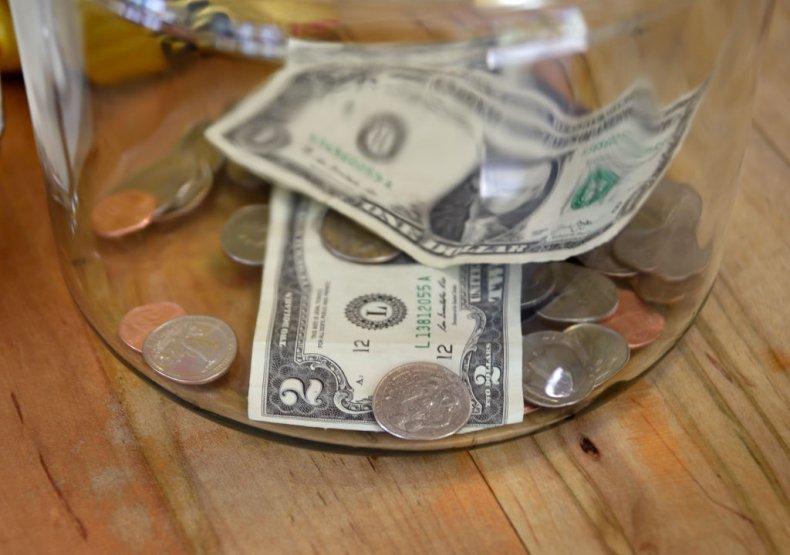 Money in a tip jar