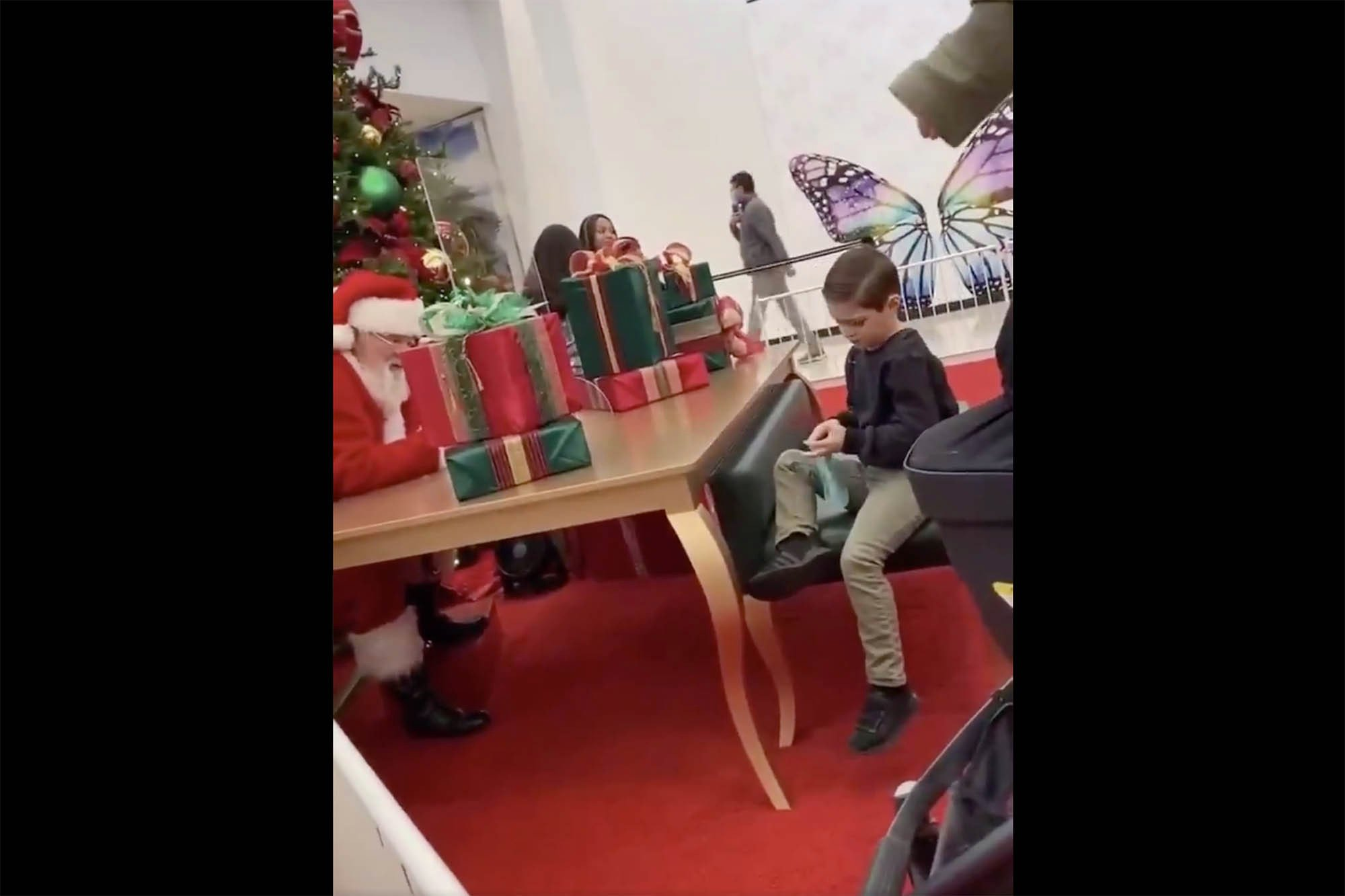 Politically correct Santa tells crying kid he won