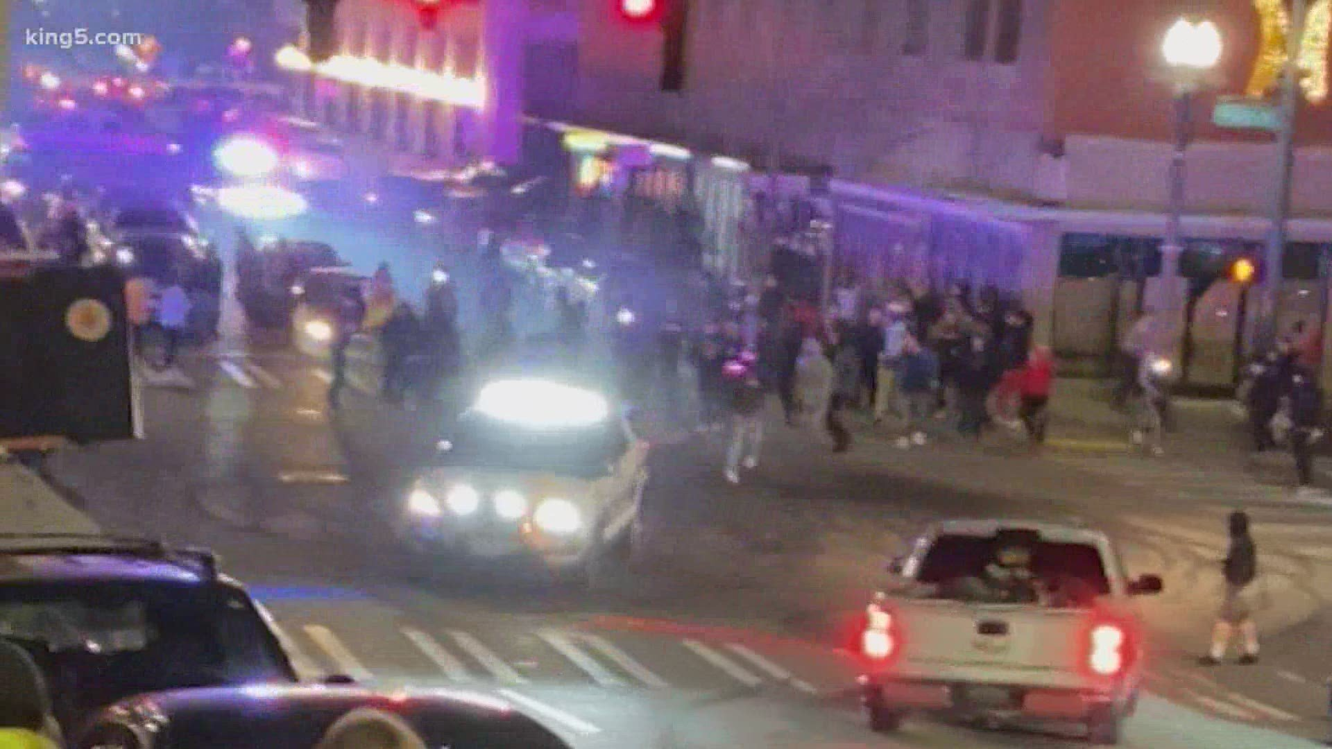 Tacoma officer who drove police car through crowd at street race has been identified | king5.com