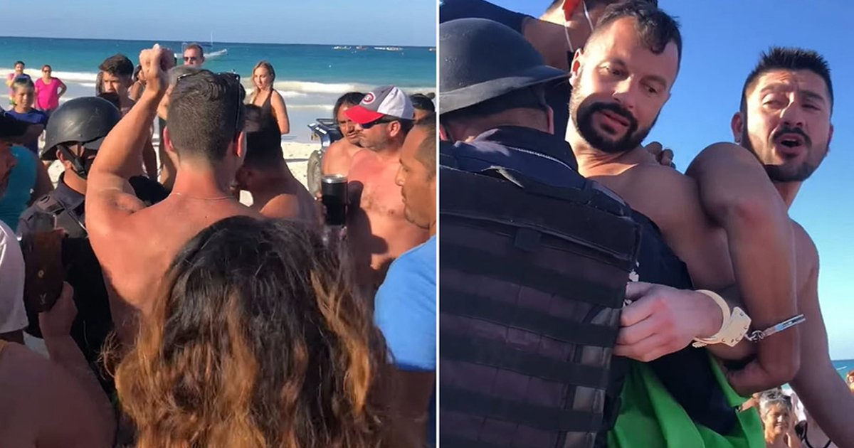 wwwwwwww.jpg?resize=412,232 - Gay Couple Handcuffed & Arrested By Cops For Kissing On Beach