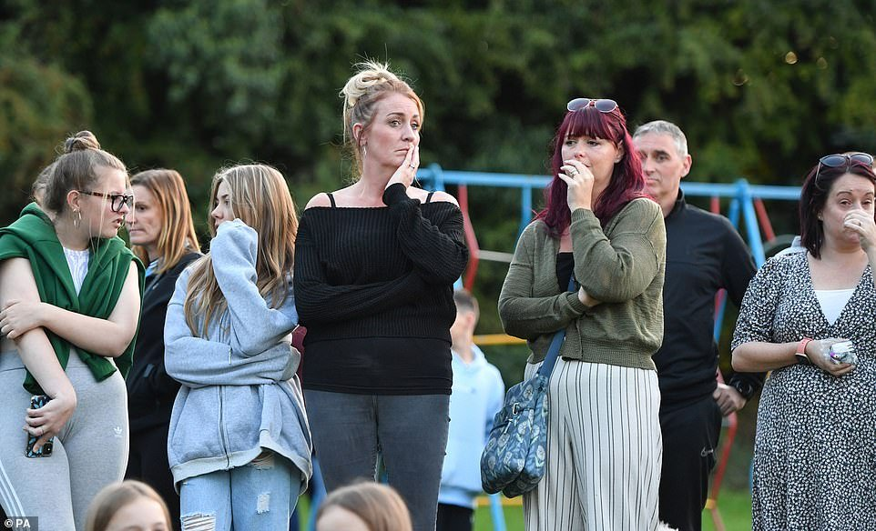 Men, women and children shed tears as they gathered at the children