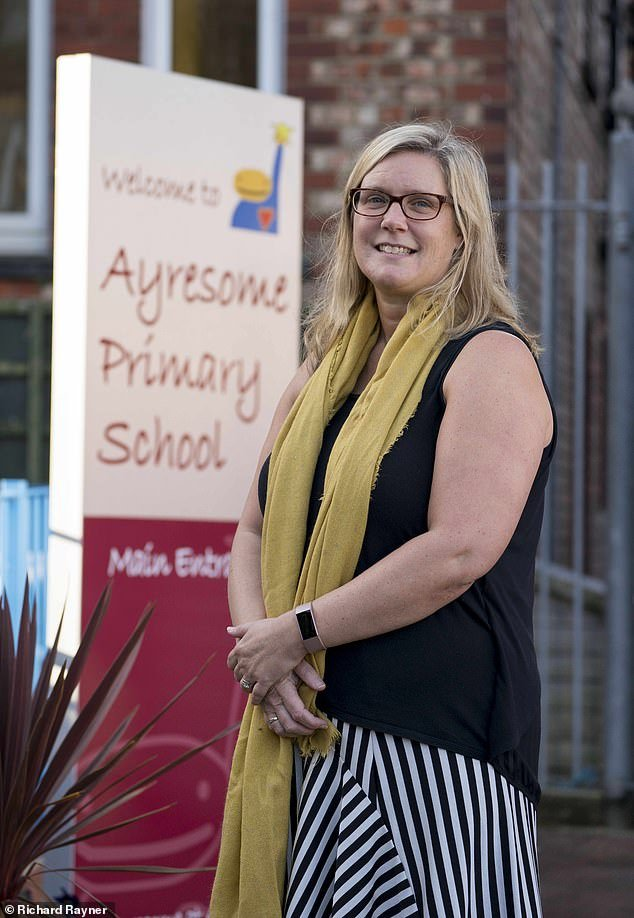 Charlotte Haylock, the Executive Head of Ayresome Primary School in Middlesbrough, who has asked parents to dress appropriately and stop bringing their children to school in dressing gowns (Above)