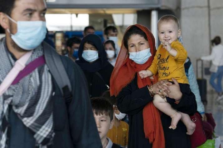 US resumes Afghan refugee flights after measles shots   World News – India TV