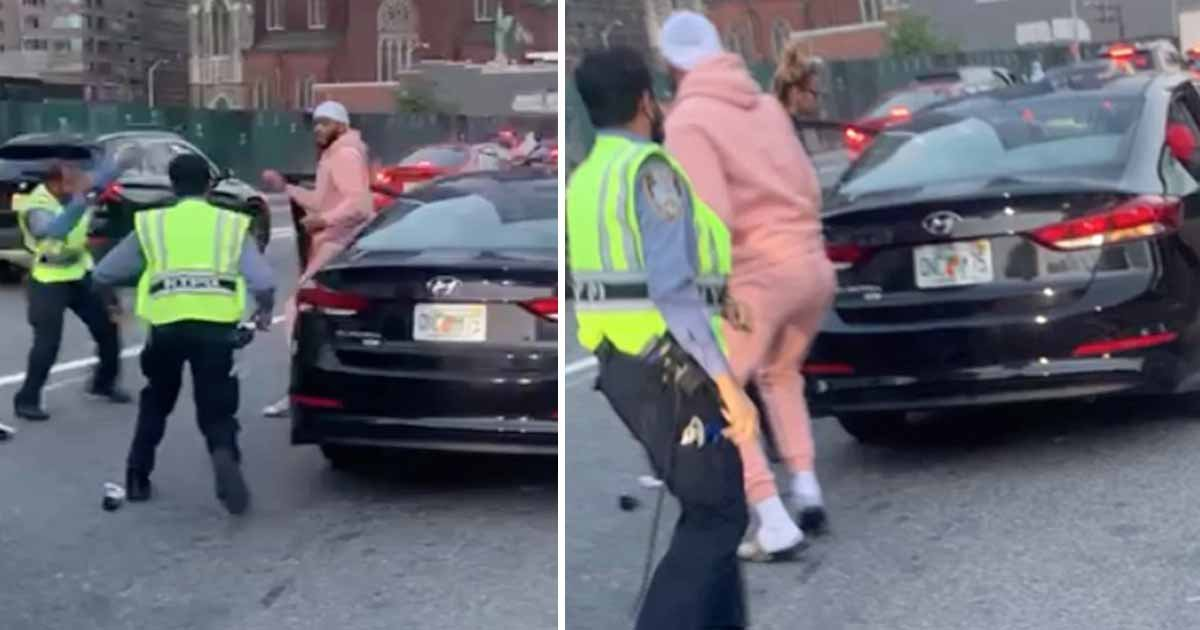 q1 2 1.jpg?resize=1200,630 - Wild Footage Shows Driver & Passengers Violently SLAMMING NYPD Traffic Officials After Fleeing Car Crash